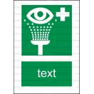 E009 - Vymývanie očí - Zvislá záchranná nálepka s doplnkovým textom
